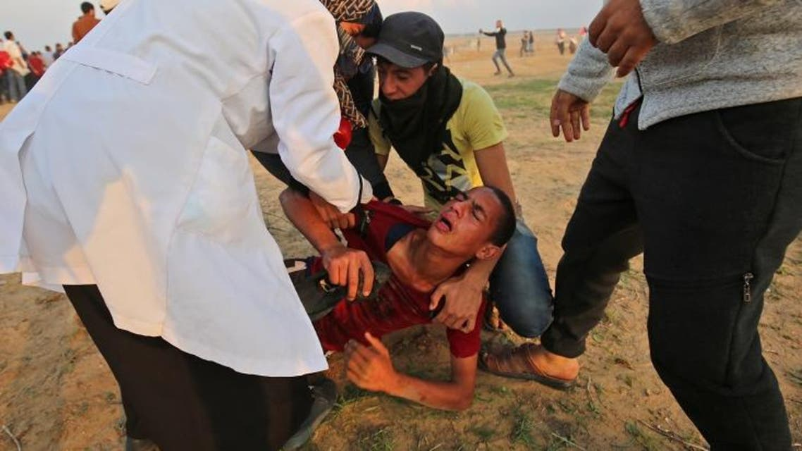 A wounded protester is evacuated during clashes near the border between Israel and Khan Yunis in the southern Gaza Strip on November 9, 2018. (AFP)