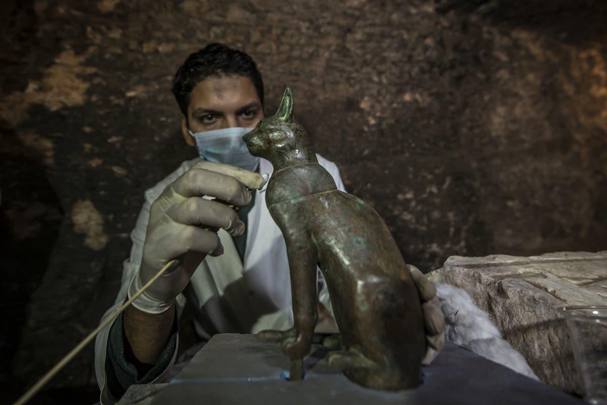 Egypt bronze ancient sitting cat statue  (AFP)