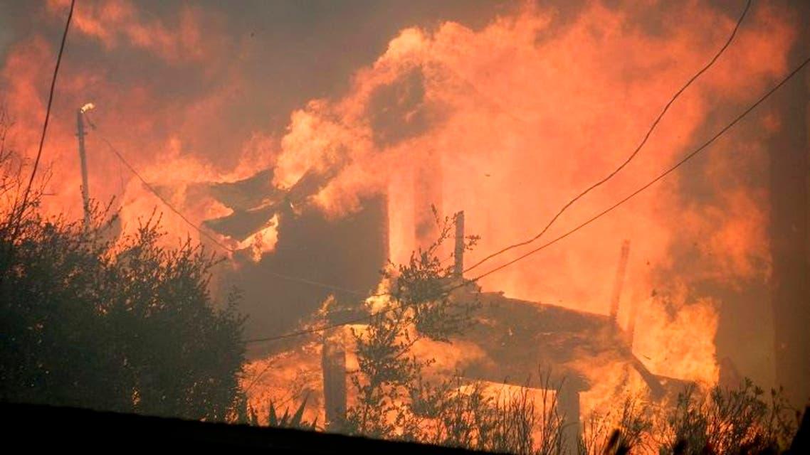A wildfire burns a structure near Malibu Lake in Malibu, Calif., Friday, Nov. 9, 2018. (AP)