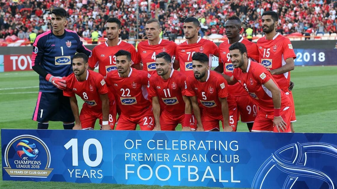File photo of Persepolis' players before the AFC Champions League quarter-final football match between Persepolis FC and al-Duhail SC at the Azadi Stadium in Tehran. (AFP)