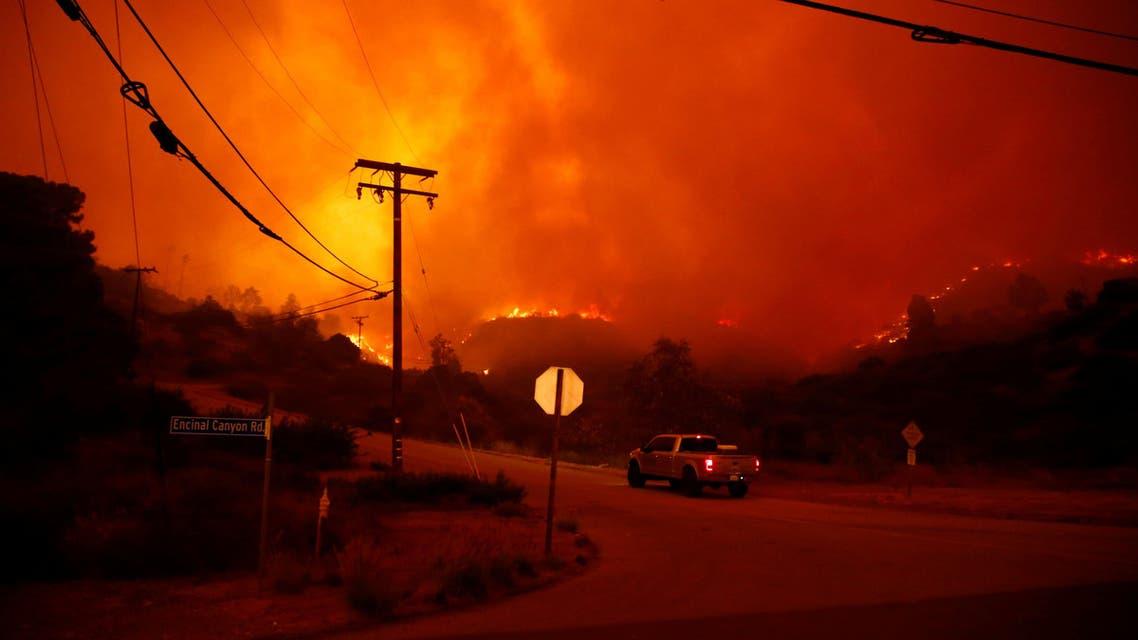 The Woosley Fire burns in Malibu, California, U.S. November 9, 2018. REUTERS/Eric Thayer