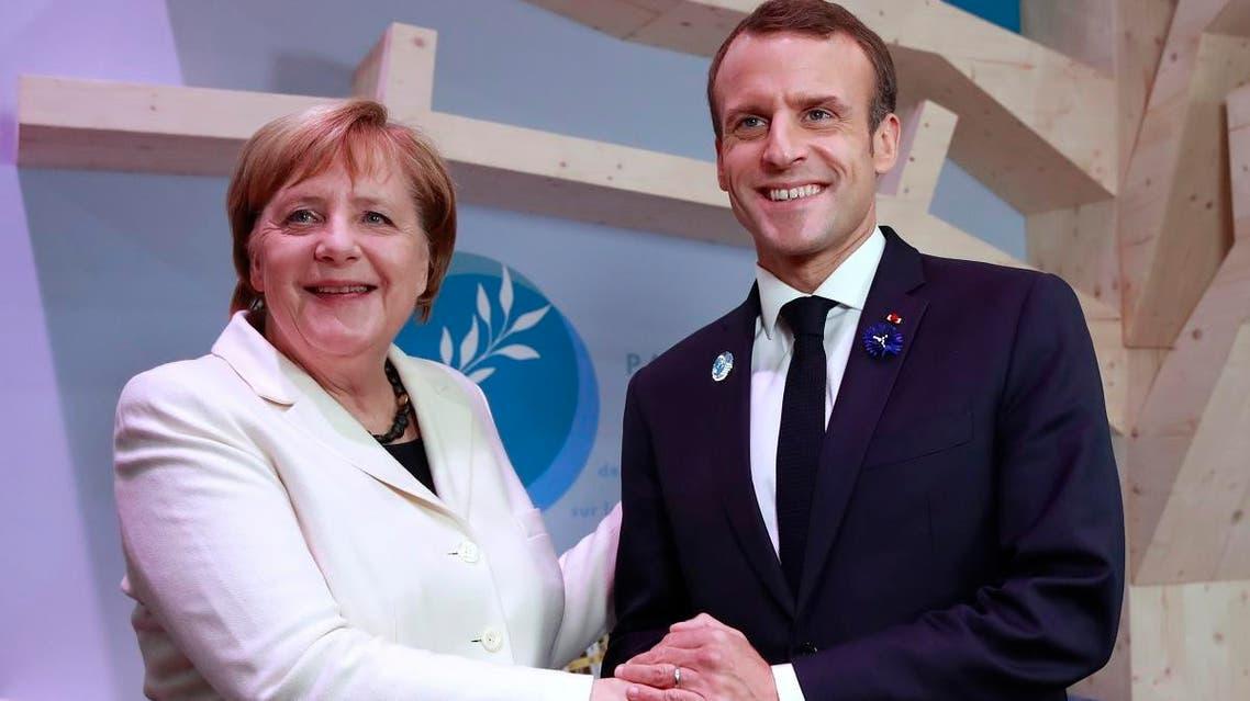 German Chancellor Angela Merkel and French President Emmanuel Macron in Paris (AP)
