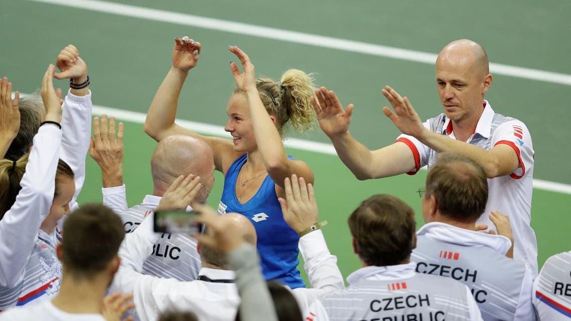 Czech Republic's Katerina Siniakova celebrates with Czech Republic team captain Petr Pala after winning her match against Alison Riske of the US. (Reuters)
