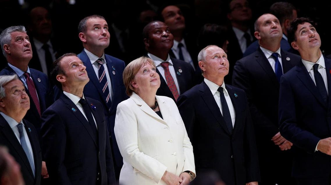 World leaders look up for a family photo at the opening of the Paris Peace Forum after the commemoration ceremony for Armistice Day. (Reuters)