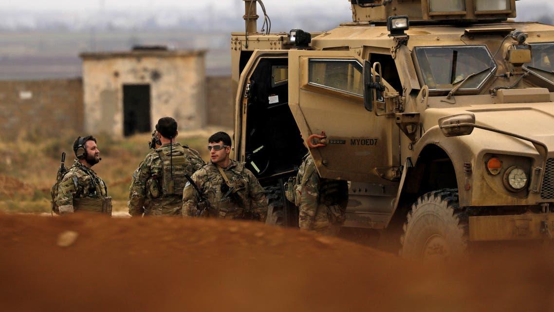 قوات سوريا الديمقراطية وجنود أميركيون