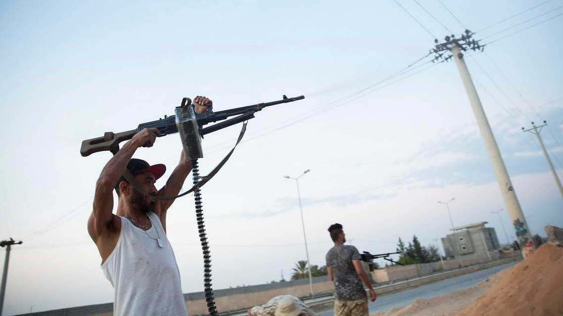 Fighters under the UN backed government shooting on the front lines during clashes in southern Tripoli. (AP)