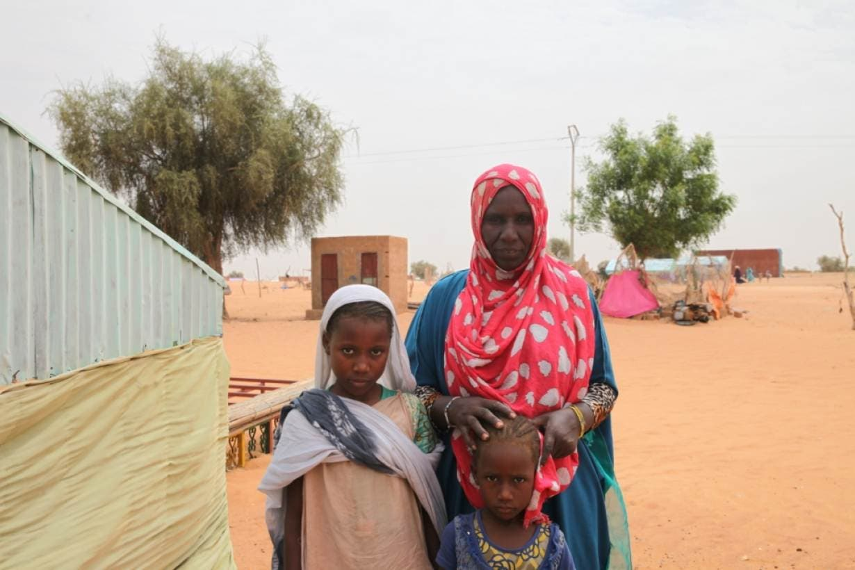 Aminetou Mint Yarg poses with family members in the commune of Dar El Barka, Mauritania, October 20, 2018. (Thomson Reuters Foundation/Nellie Peyton)