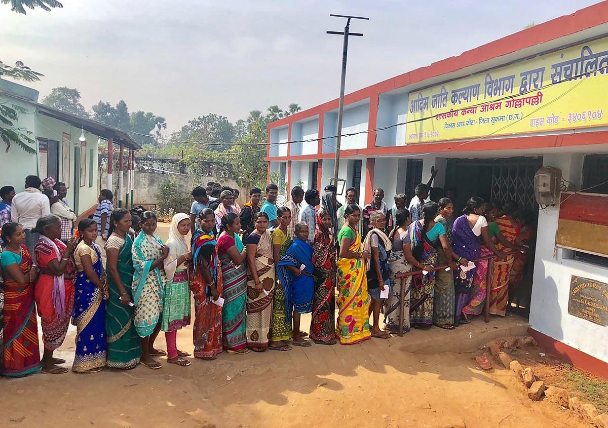 Indian voters line up to vote at a polling station in Sukma in Chhattisgarh state on November 12, 2018. (AFP)