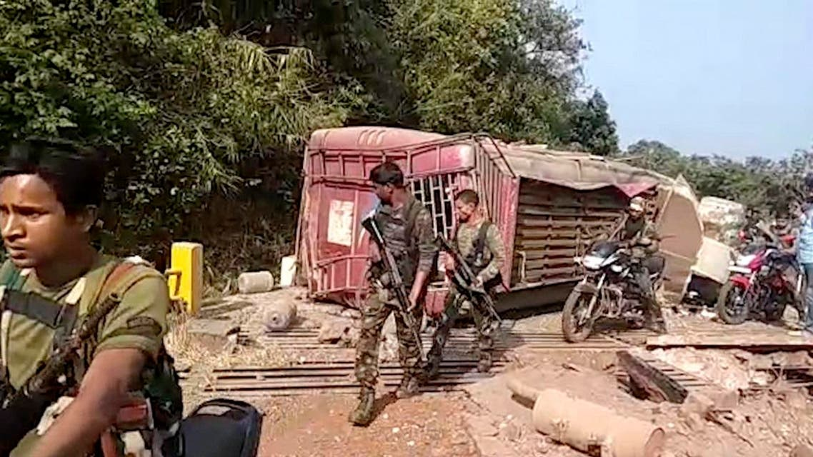 In this grab made from video provided by KK Productions, Indian paramilitary soldiers walk past the remains of a bus that was blown up by Maoist rebels in Dantewada district of Chhattisgarh state, India, Thursday, Nov. 8, 2018. (AP)