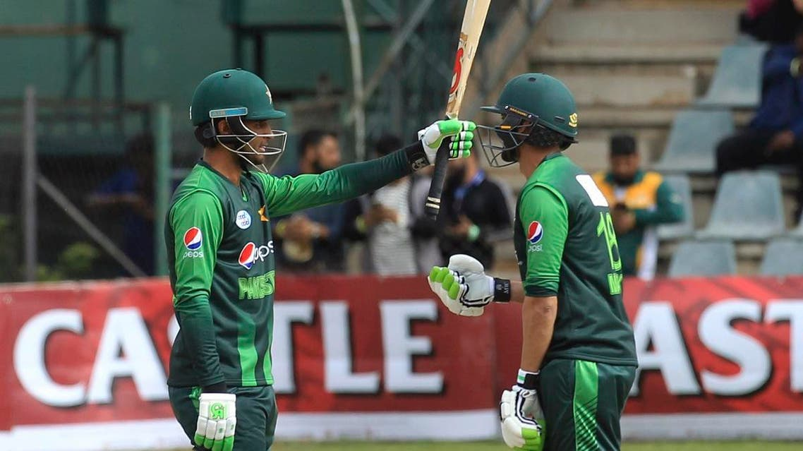 Pakistan's Fakhar Zaman, (left), celebrates after scoring 50 runs on the final day of the T20 cricket match between Australia and Pakistan at the Harare Sports Club, in Harare, on  July 8, 2018. (AP)