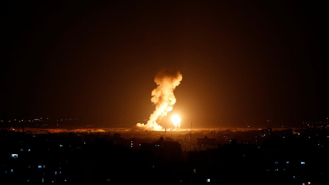 Smoke and flame are seen during an Israeli air strike in Gaza. (Reuters)