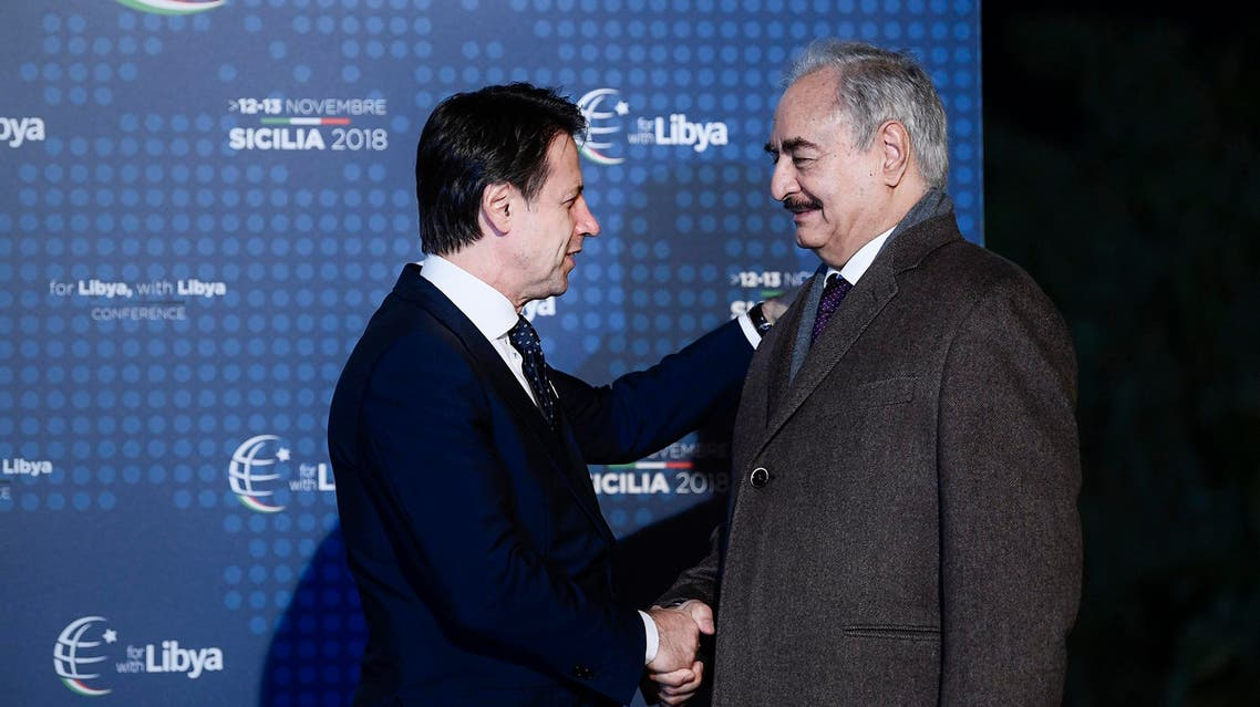 Italian Prime Minister Giuseppe Conte (L) greets Libya Chief of Staff, Marshall Khalifa Haftar upon his arrival for a conference on Libya on November 12, 2018. (AFP)