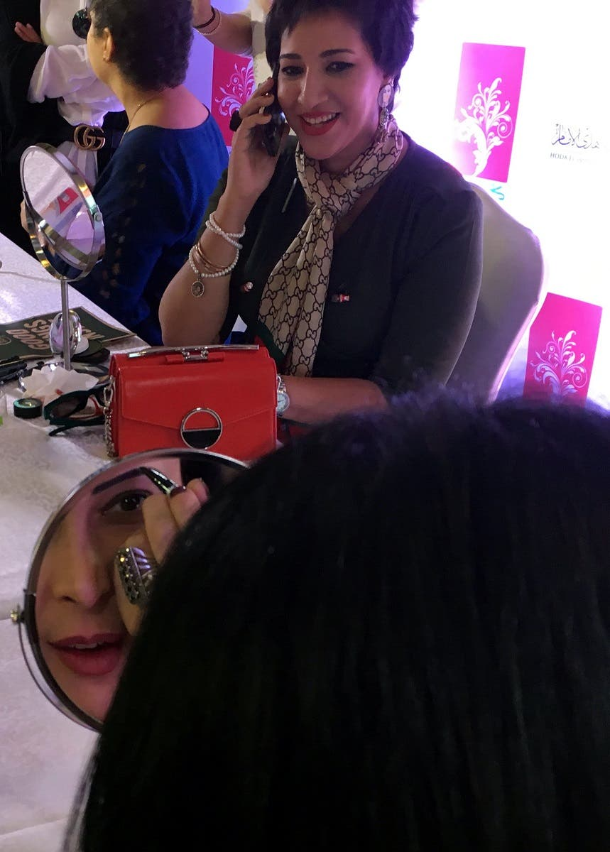 Cancer patients Merhan Khalil talks while Merhan Khalil looks during a workshop to receive makeup tips at Cairo's Marriott Hotel. (Reuters)