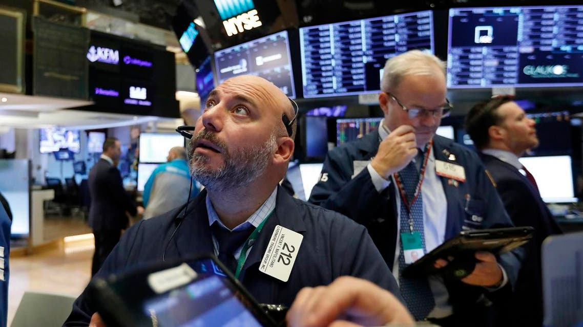 Trader Vincent Napolitano, left, works on the floor of the New York Stock Exchange, Friday, Nov. 9, 2018. Stocks are falling as energy companies are dragged lower by the continuing plunge in crude oil prices. (AP