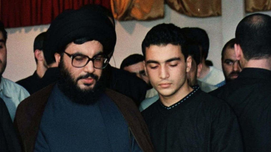 Hassan Nasrallah and his son Jawad view the body of his eldest son Hadi, who was killed in fighting with Israeli forces in south Lebanon in 1997. (File photo: Reuters)