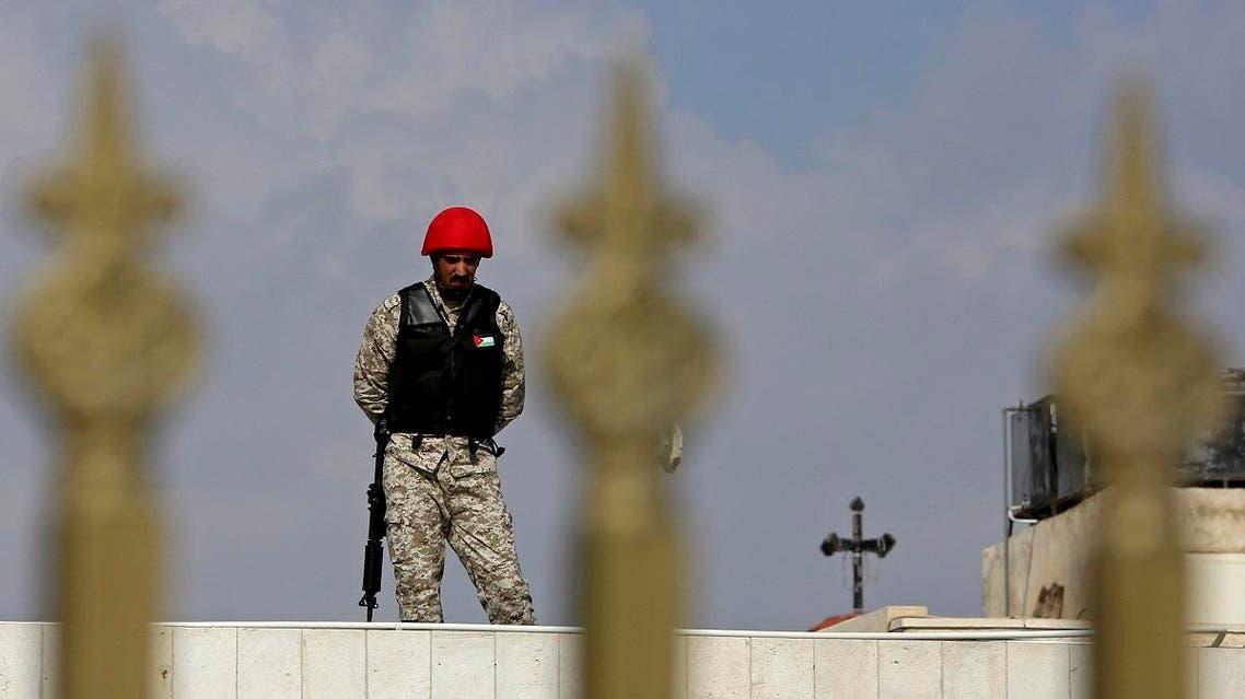 A guard defends a state security court as judges sentenced 10 defendants to prison. (AP)