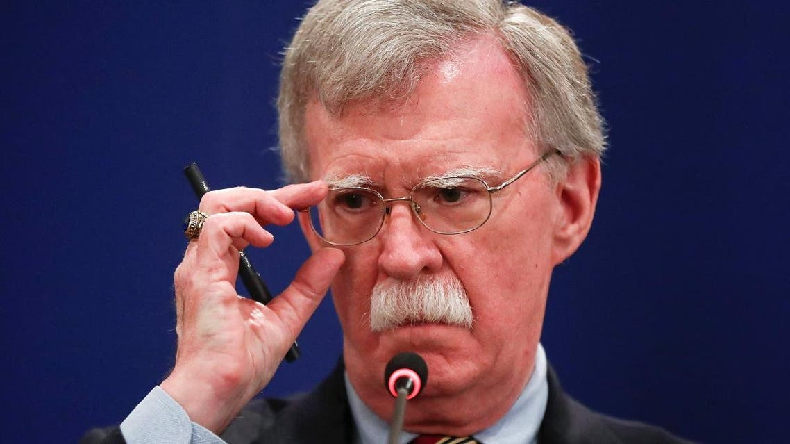 US National Security Adviser John Bolton adjusts glasses during a news briefing. (Reuters)