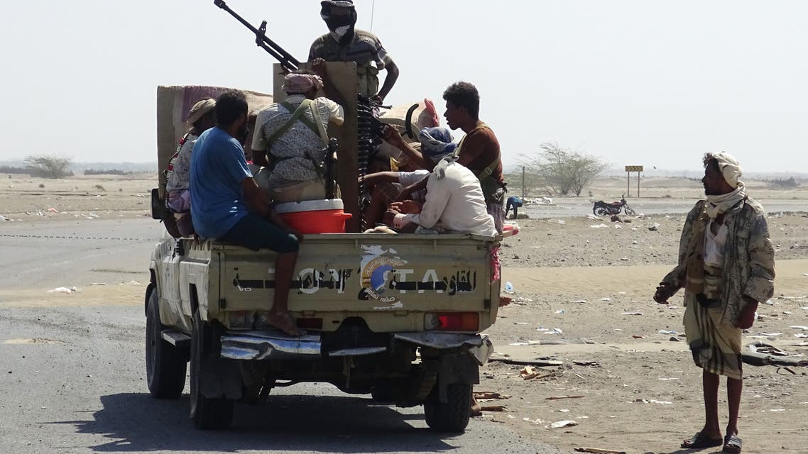 Yemeni pro-government forces gather in a street on the eastern outskirts of Hodeida as they continue to battle for the control of the city from Huthi rebels on November 13, 2018. Diplomatic efforts to end fighting in Yemen's Hodeida intensified today, as Britain said the Saudi-led coalition had agreed to the evacuation of wounded rebels from the country ahead of proposed peace talks in Sweden.