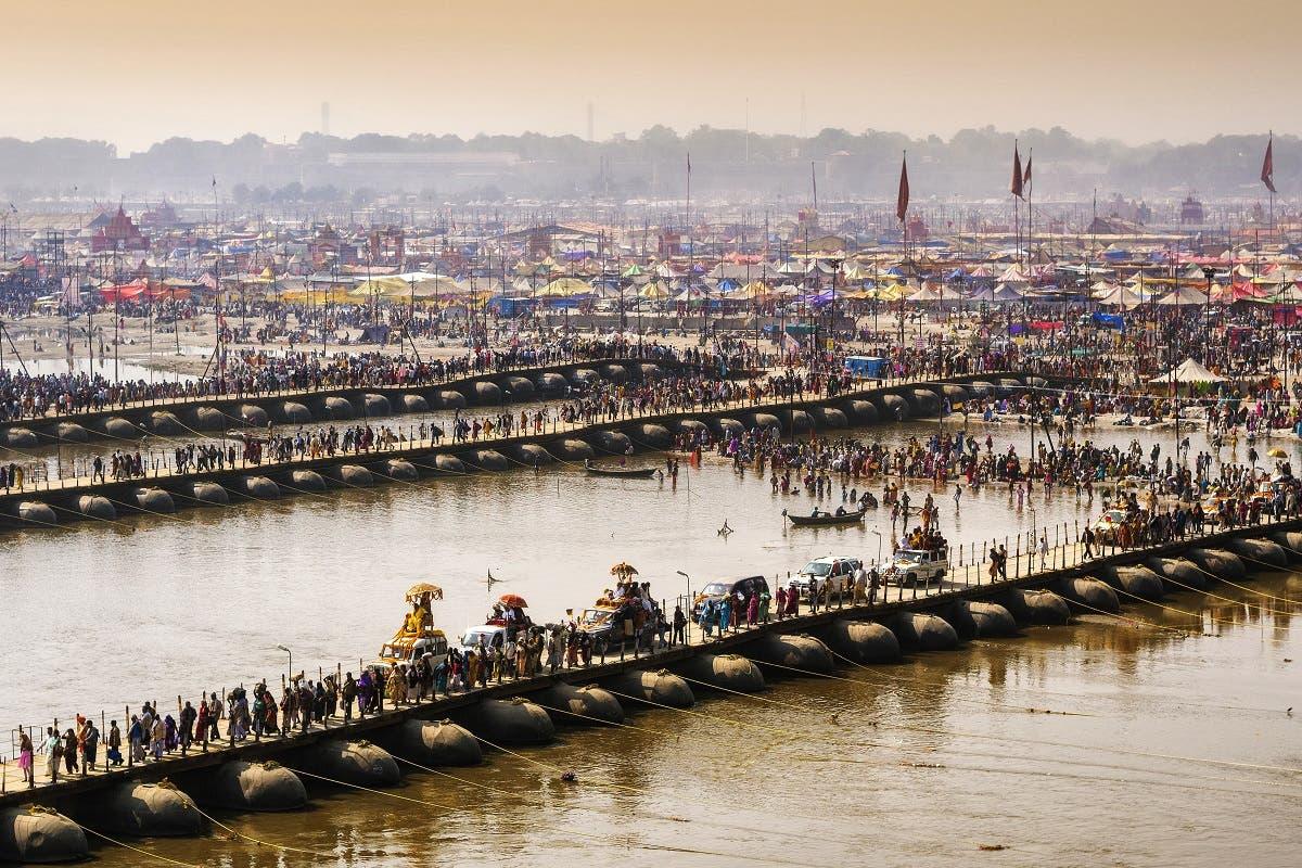 Kumbh Mela festival in Allahabad, Uttar Pradesh, India, crowd crossing pontoon bridges over the Ganges river. (Shutterstock)