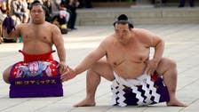 Sumo wrestling grand champion pulls out after fourth successive loss
