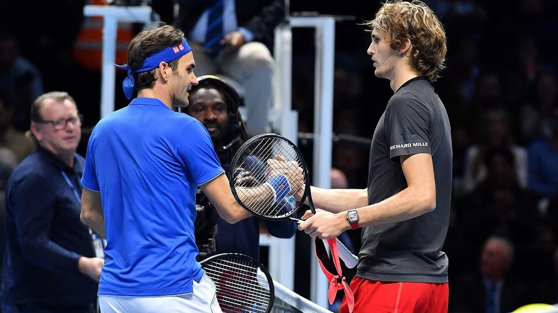 Alexander Zverev (R) shakes hands after winning against Roger Federer during their men's singles semi-final match of the ATP World Tour Finals tennis tournament at the O2 Arena in London on November 17, 2018. (AFP)