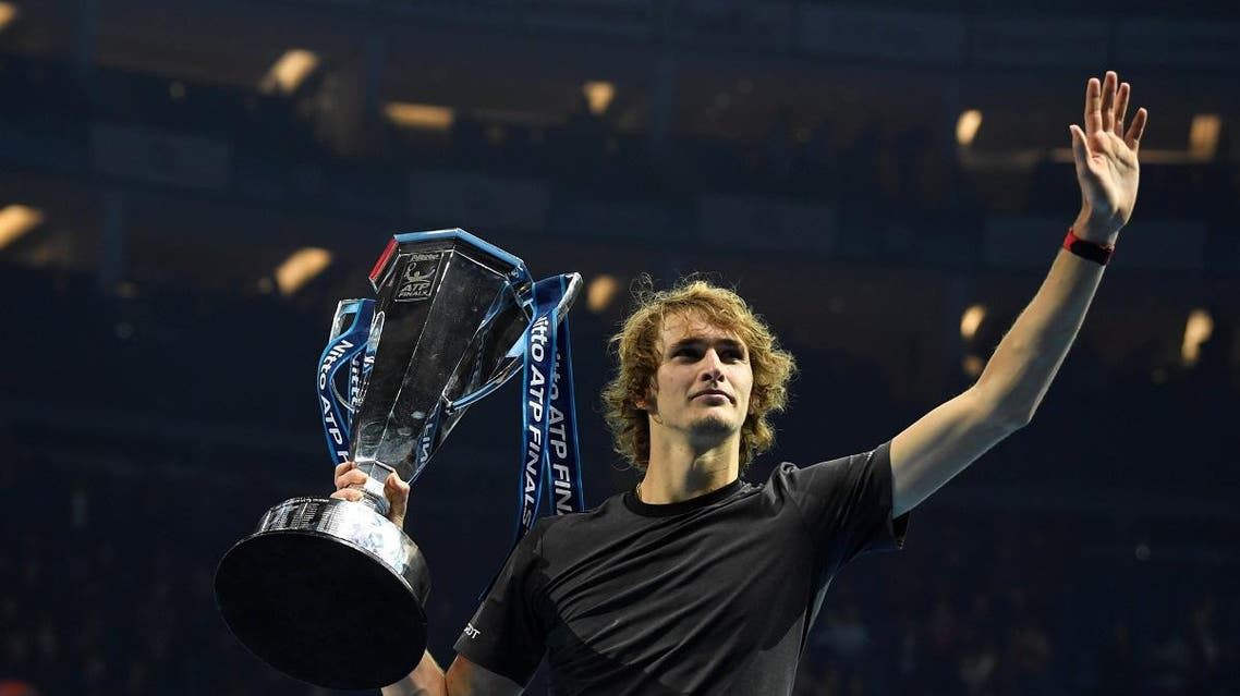 Alexander Zverev celebrates with the trophy after winning the final against Novak Djokovic. (Action Images via Reuters)