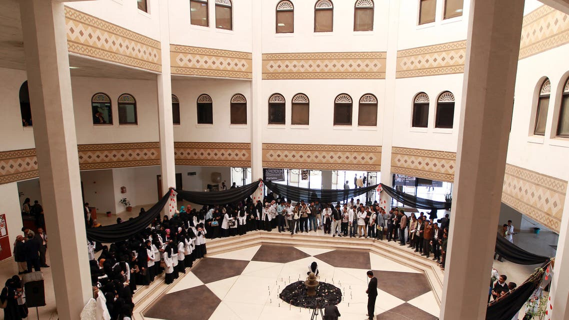 Yemeni university students at the School of Medicine in Sanaa attend a ceremony to commemorate the first anniversary of the victims of a suicide attack that targeted the Yemeni Defense Ministry killing many that worked in a hospital within the complex on December 4, 2014. A suicide bomber rammed an explosives-packed car into the Yemeni defence ministry complex in December 5, 2013, followed by an armed assault in which 52 people died, including seven foreign medical staff. AFP PHOTO / MOHAMMED HUWAIS
