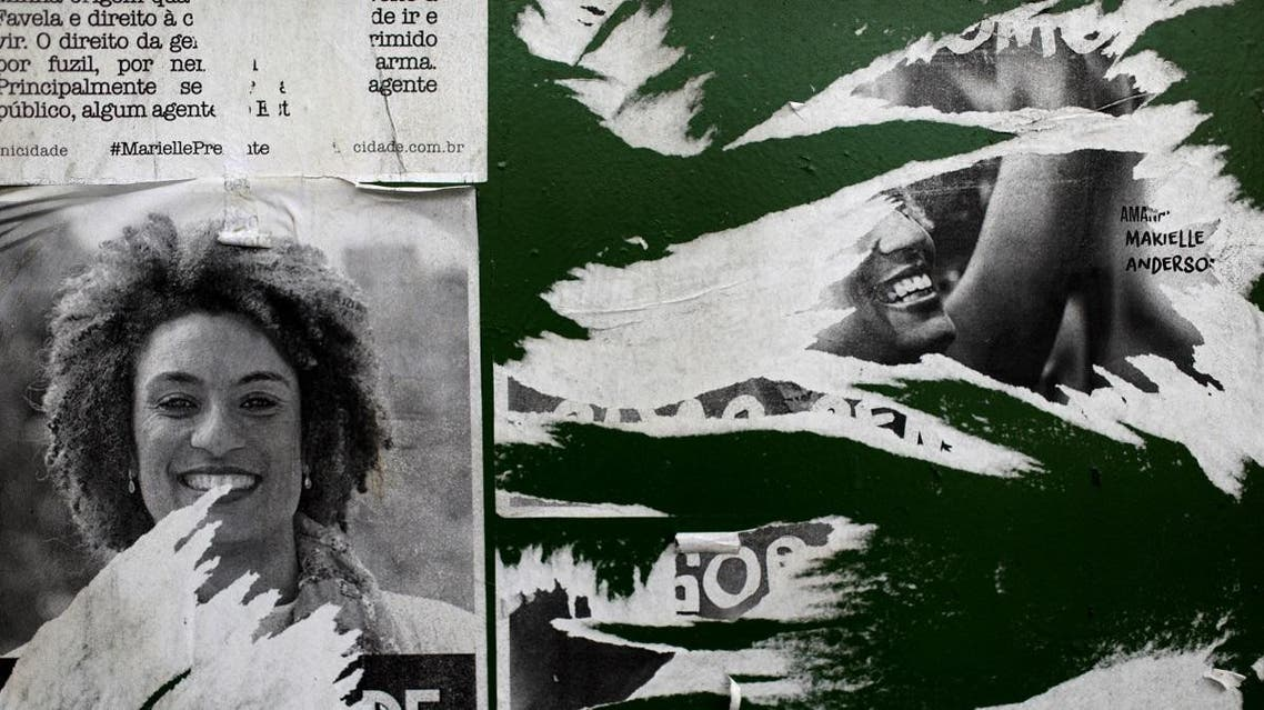 Pictures of Rio de Janeiro city councilor Marielle Franco are seen, where she was shot dead in Rio de Janeiro. (Reuters)