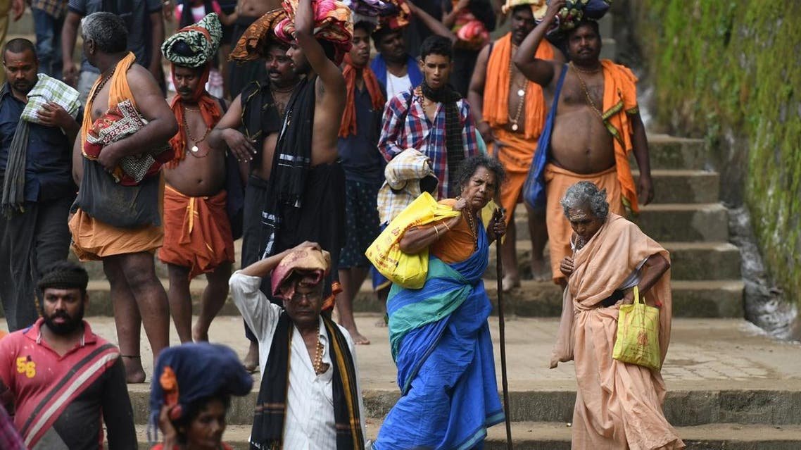 This photo taken on November 18, 2018 shows elderly Hindu women trekking to the Sabarimala temple in the southern state of Kerala. Tens of thousands of pilgrims have thronged to the hilltop shrine ahead of a Supreme Court ruling November 19 on whether it should be given more time to let women enter. (AFP)
