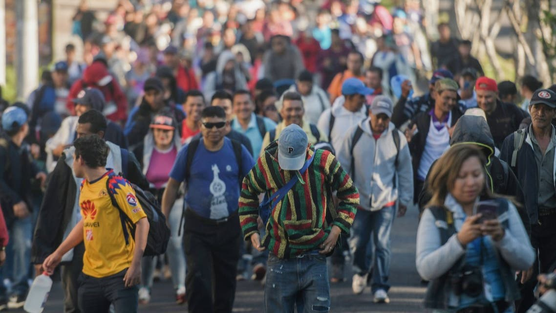 """Salvadoran migrants begin their journey in caravan heading the United States, in San Salvador, on November 18, 2018. The migrants are mostly fleeing poverty and unrest in Central America's """"Northern Triangle"""" -- El Salvador, Guatemala and Honduras, where brutal gang violence has fuelled some of the highest murder rates in the world."""