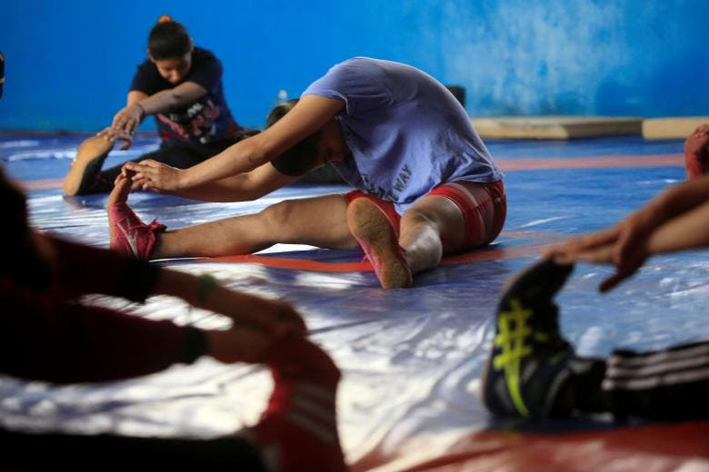 Grappling with taboos, Iraqi women join wrestling squad