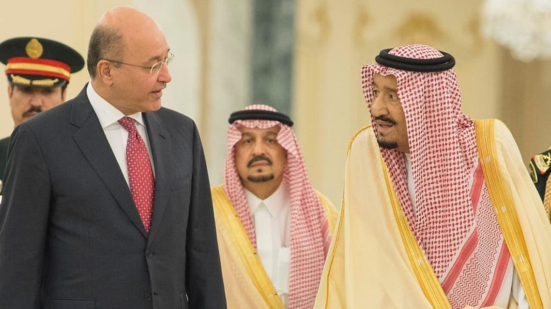 Saudi King Salmanand Iraqi President Salih (AFP)