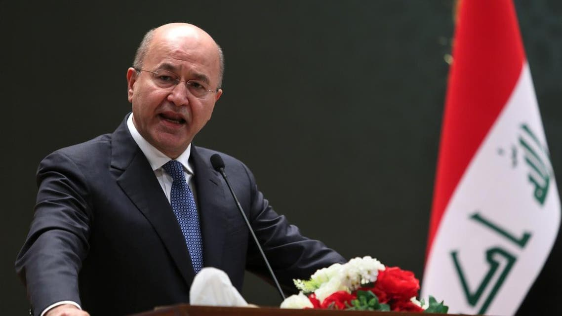 A picture released by the Iraqi Parliament shows the newly elected Iraqi President Kurdish Barham Saleh delivering a speech on October 2, 2018 at the parliament in Baghdad. (AFP)