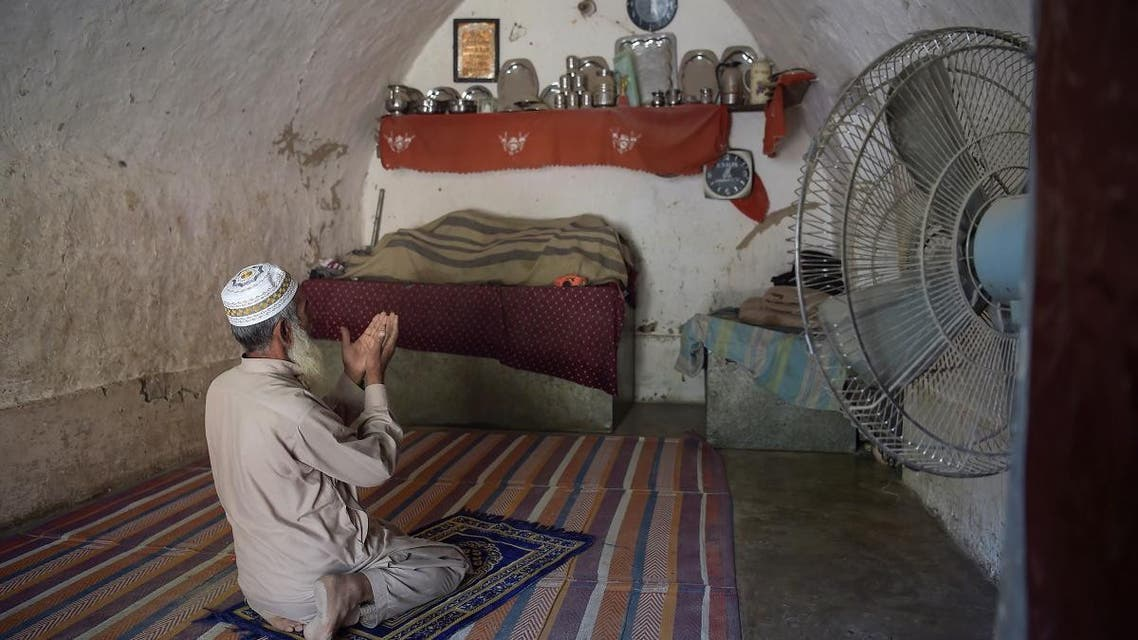 Pakistan cave homes. (AFP)