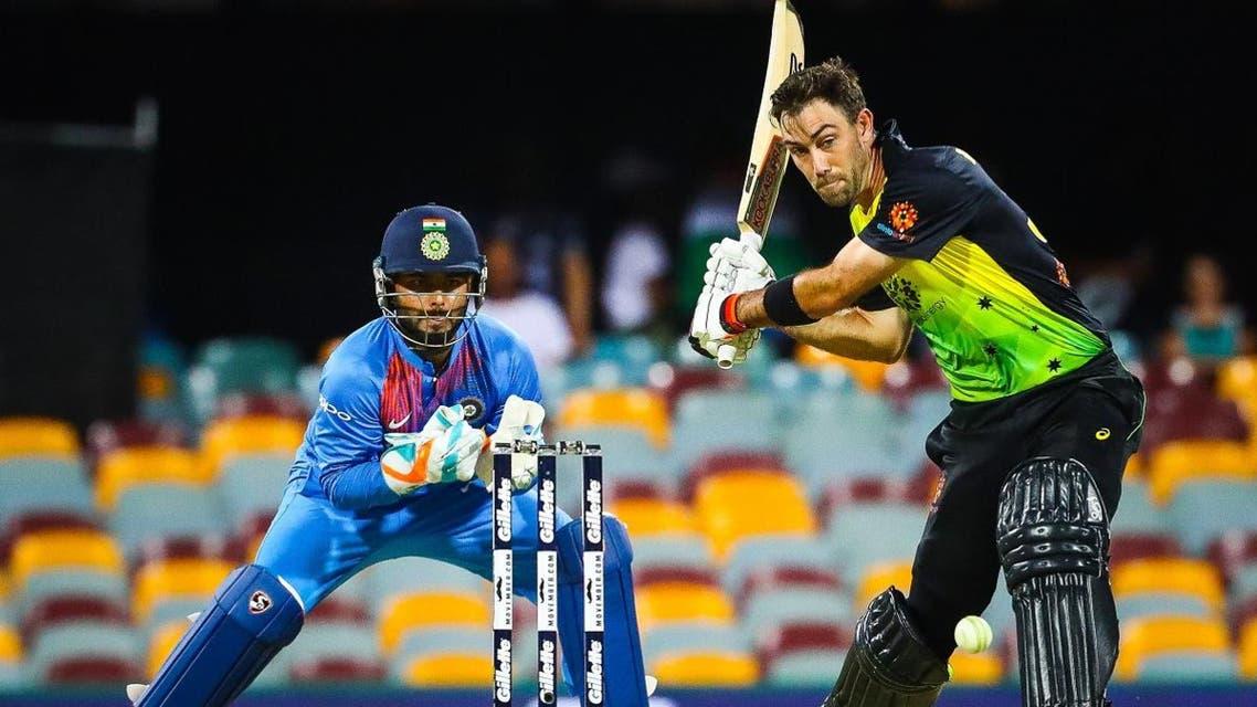 Australia's batsman Glenn Maxwell (R) hits a shot off the bowling of India's Krunal Pandya during the T20 international cricket match between Australia and India in Brisbane on November 21, 2018.