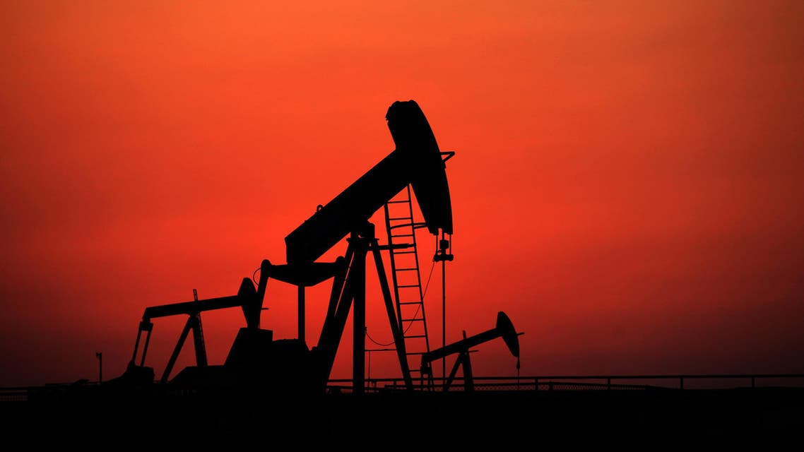 Oil pumps work at sunset on Wednesday, Sept. 11, 2013, in the desert oil fields of Sakhir, Bahrain. (AP)