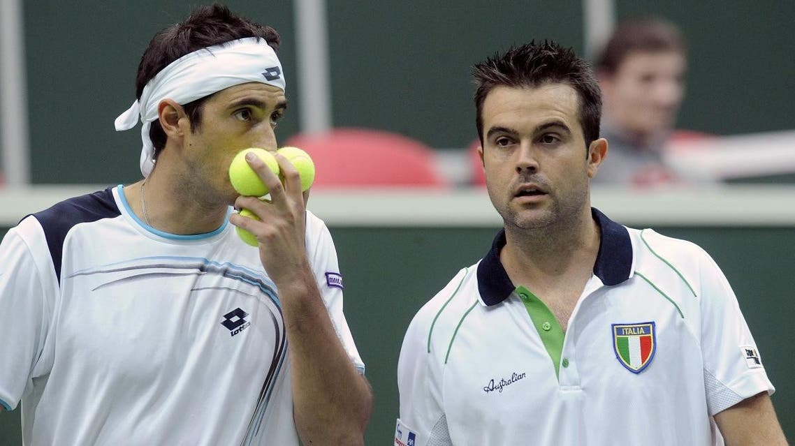 Potito Starace of Italy (L) talks with teammate Daniele Bracciali as they play during their match in first round World group of Davis Cup in 2012. (AFP)