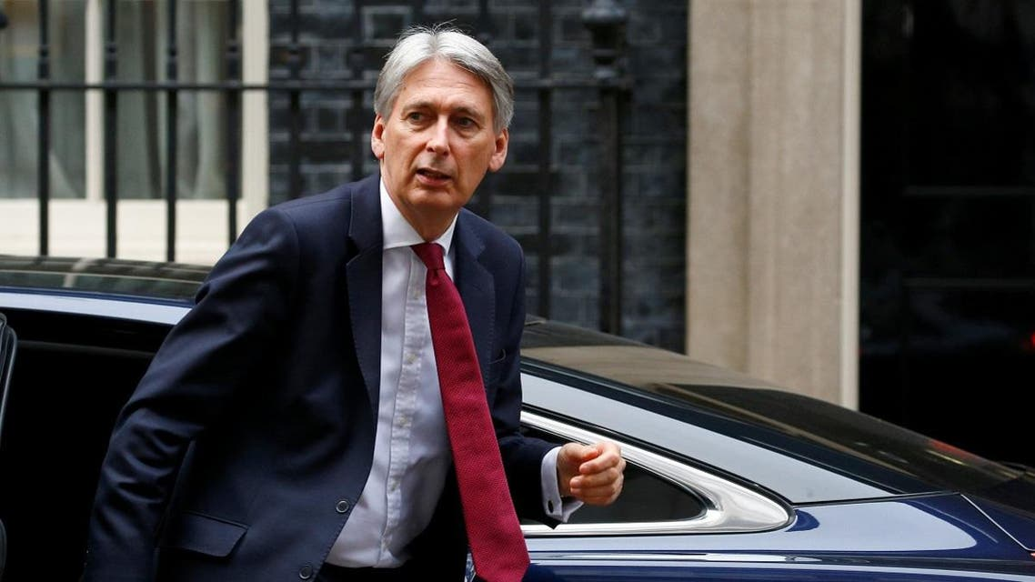 Britain's Chancellor of the Exchequer, Philip Hammond, arrives back at 11 Downing Street, in London. (Reuters)