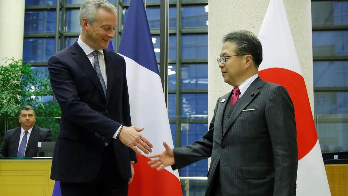 French Finance Minister Bruno Le Maire shakes hands with Japan's Minister of Economy, Trade and Industry Hiroshige Seko after a meeting around Renault-Nissan in Paris on November 22, 2018. (Reuters)