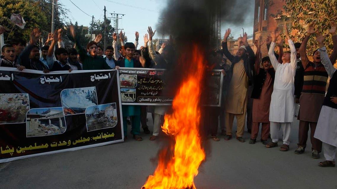 Pakistani students protest to condemn a bombing in Orakzai, in Peshawar, Pakistan. (AP)