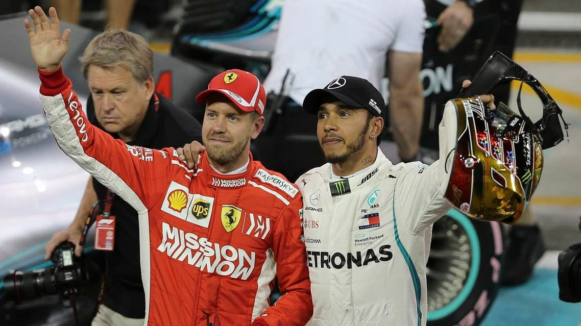 Mercedes driver Lewis Hamilton (right), and Ferrari driver Sebastian Vettel wave after the qualifying session at the Yas Marina racetrack in Abu Dhabi, UAE, on Saturday November 24, 2018.  (AP)
