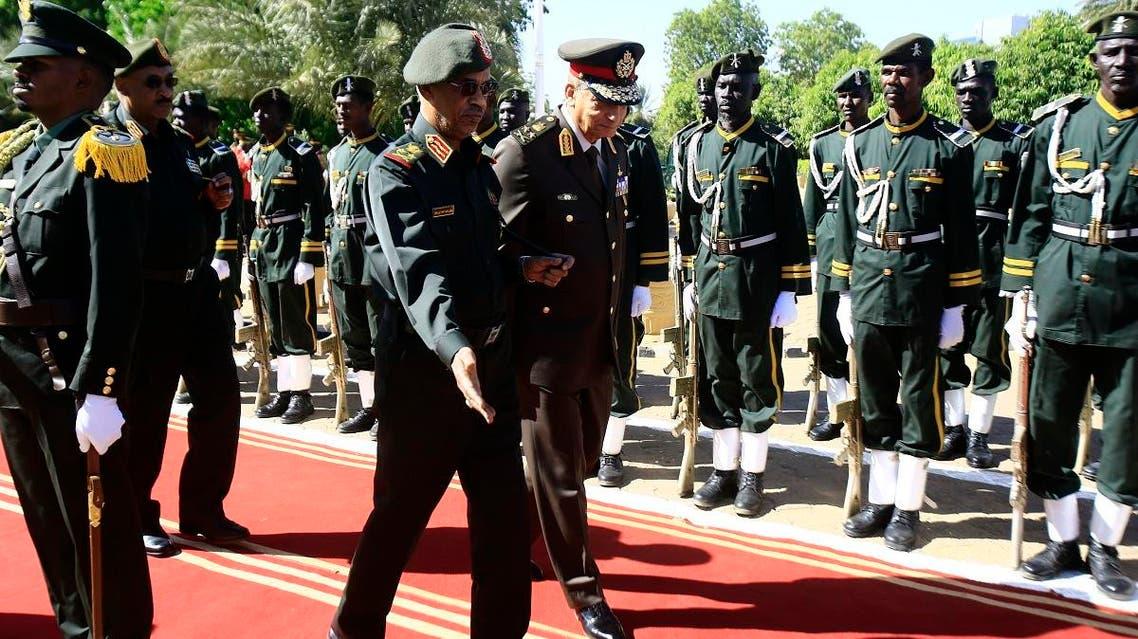 Egypt's Minister of Defense Mohamed Ahmed Zaki (R) and Sudan Minister of Defense Ahmed Awad Ibn Auf in Khartoum 3 (AFP)