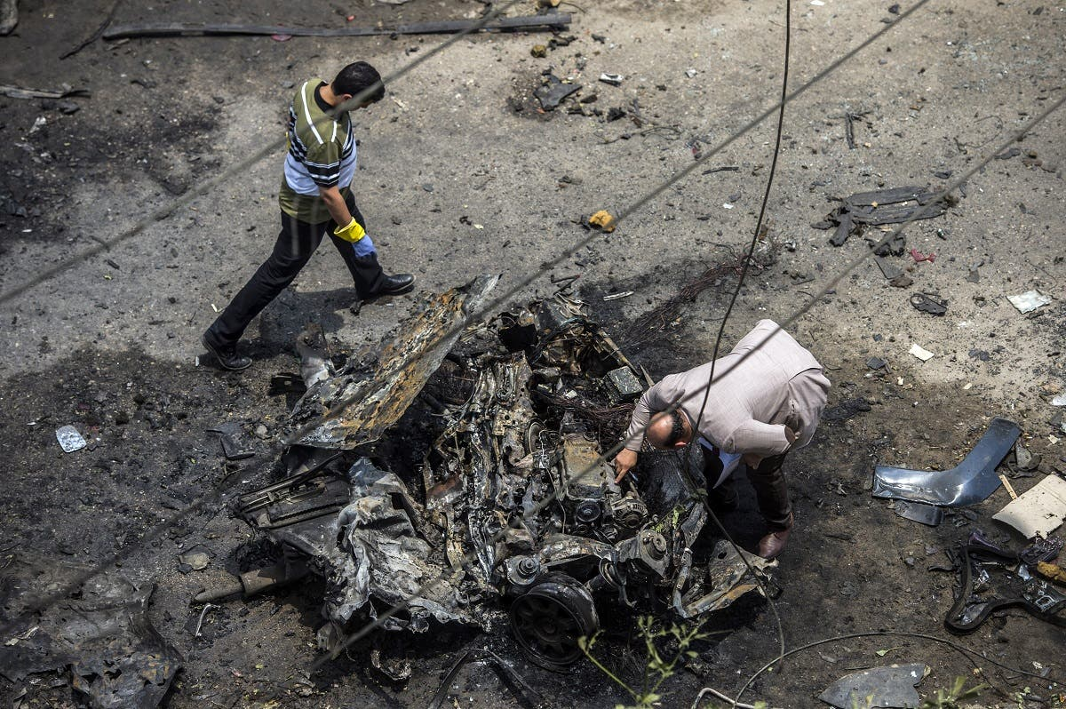Forensic detectives gather at the site of a bomb that targeted the convoy of the Egyptian state prosecutor, Hisham Barakat, in the capital Cairo on June 29, 2015.afp