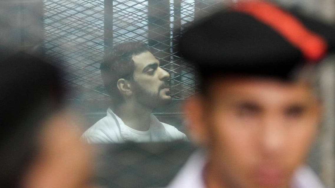 Egyptian defendants accused of forming a militant cell that assassinated state prosecutor Hisham Barakat in 2015 sit behind bars on June 17, 2017, during a court hearing in the capital Cairo.