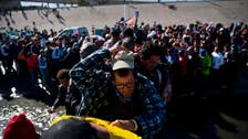 After hundreds of Mexicans tried to breach fence, US re-opens border crossing