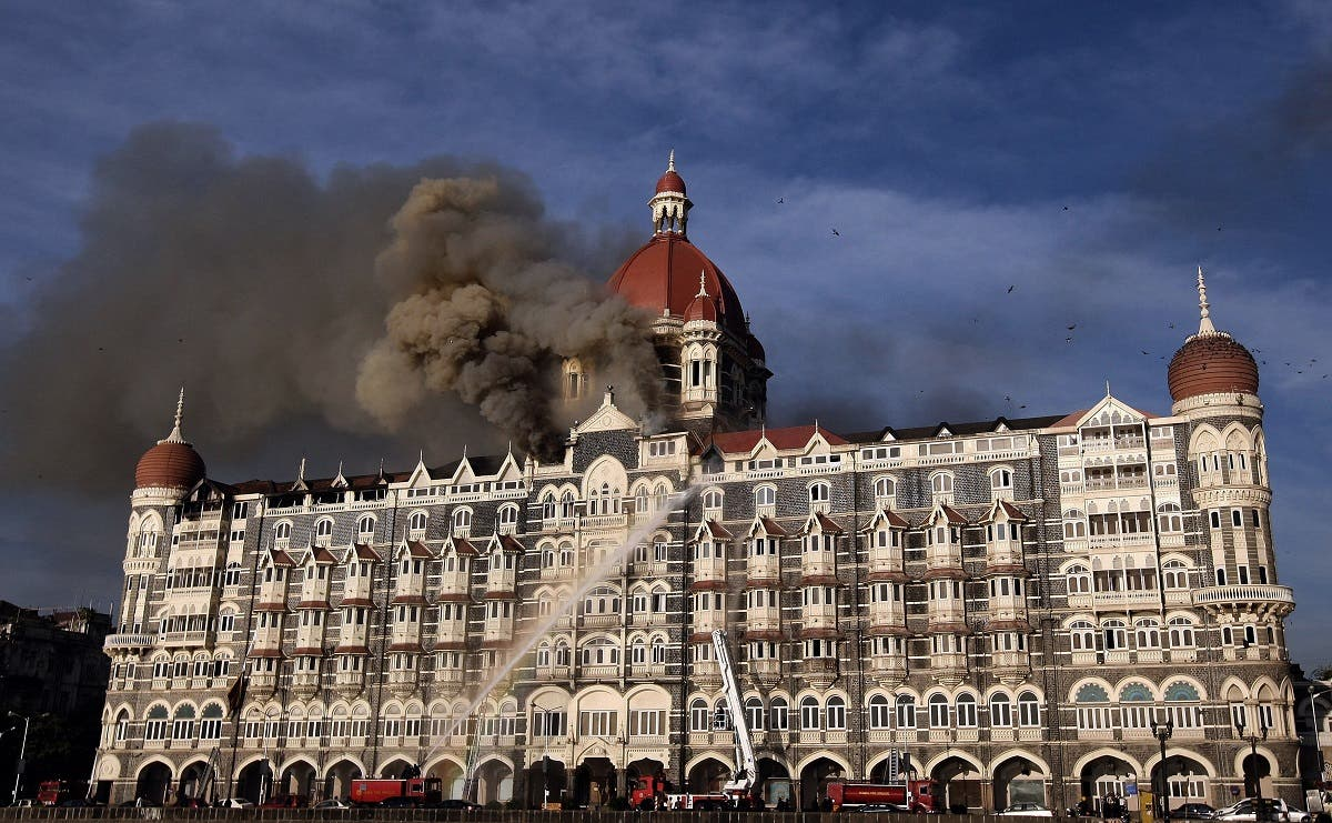In this file photo taken on November 27, 2008 Indian firefighters attempt to put out a fire as smoke billows from the Taj Mahal Palace hotel in Mumbai. (AFP)