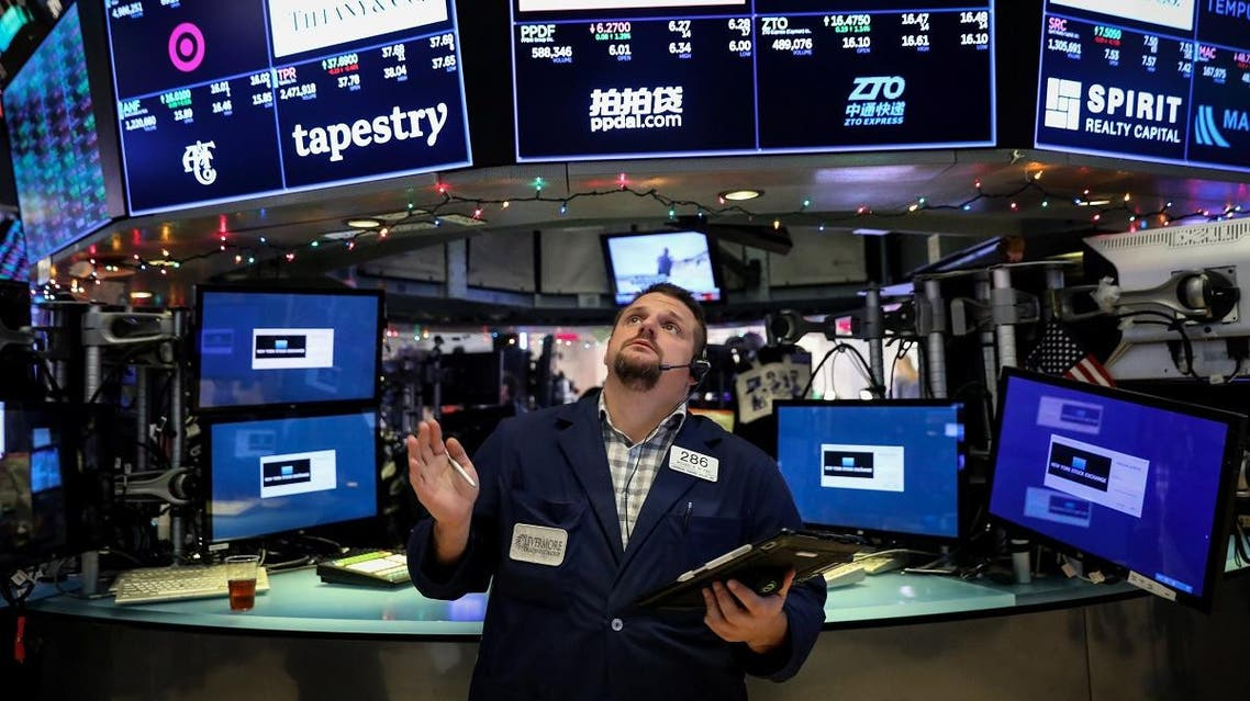 A Trader works on the floor at the New York Stock Exchange (NYSE) in New York City. (Reuters)