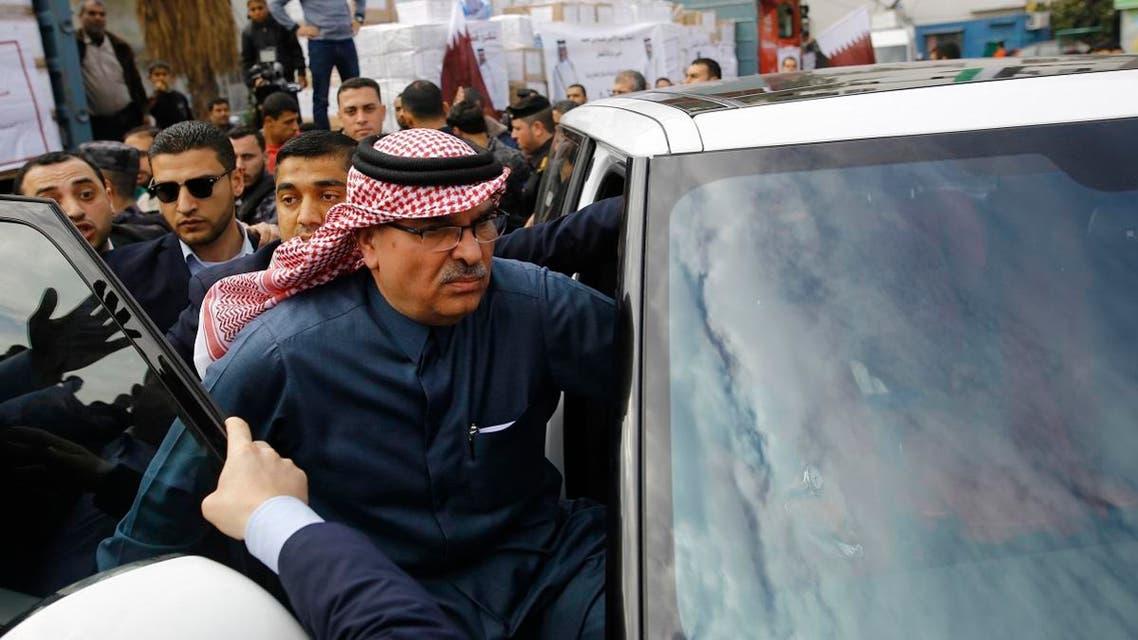 Qatari Ambassador to Gaza Mohammed al-Emadi (C) leaves following a press conference at the Dar al-Shifa hospital in Gaza. (AFP)