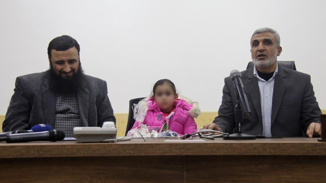 Syria's Hayat Tahrir al Sham return 4-year-old girl to her belgian mother. (AFP)