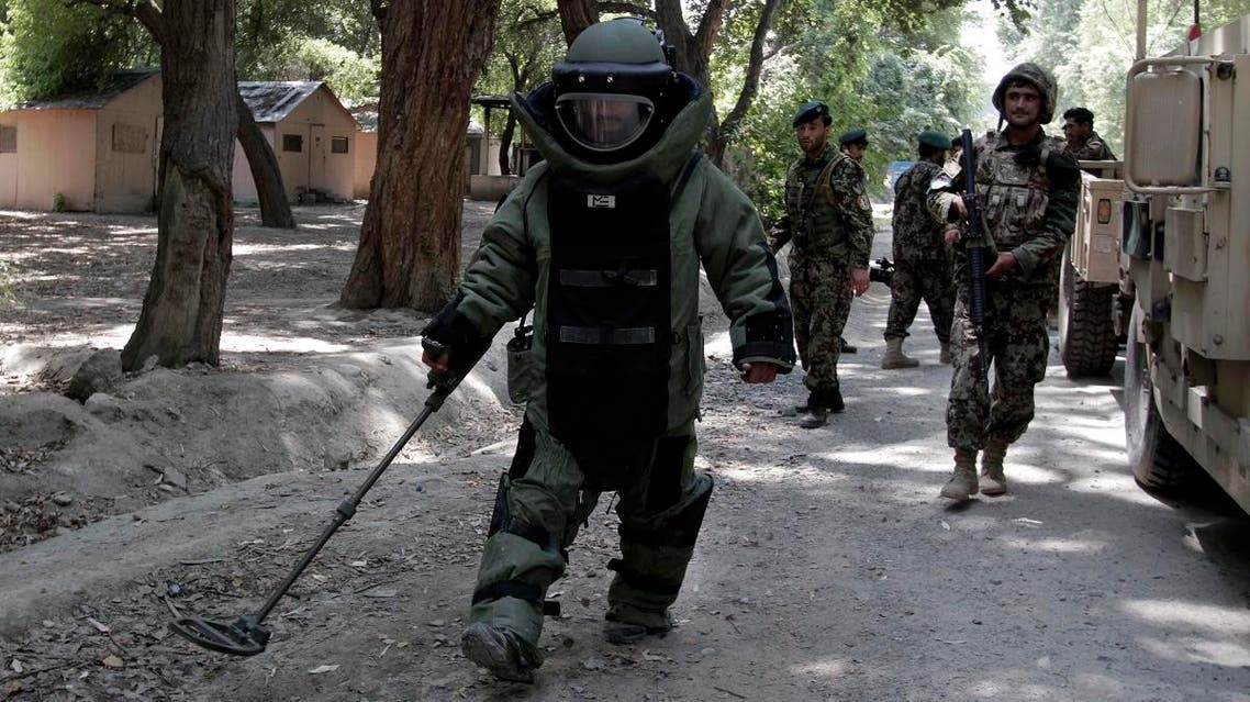 File photo of an Afghan army soldier searching for land mines with a metal detector during an IED, or improvised explosive device. (AP)